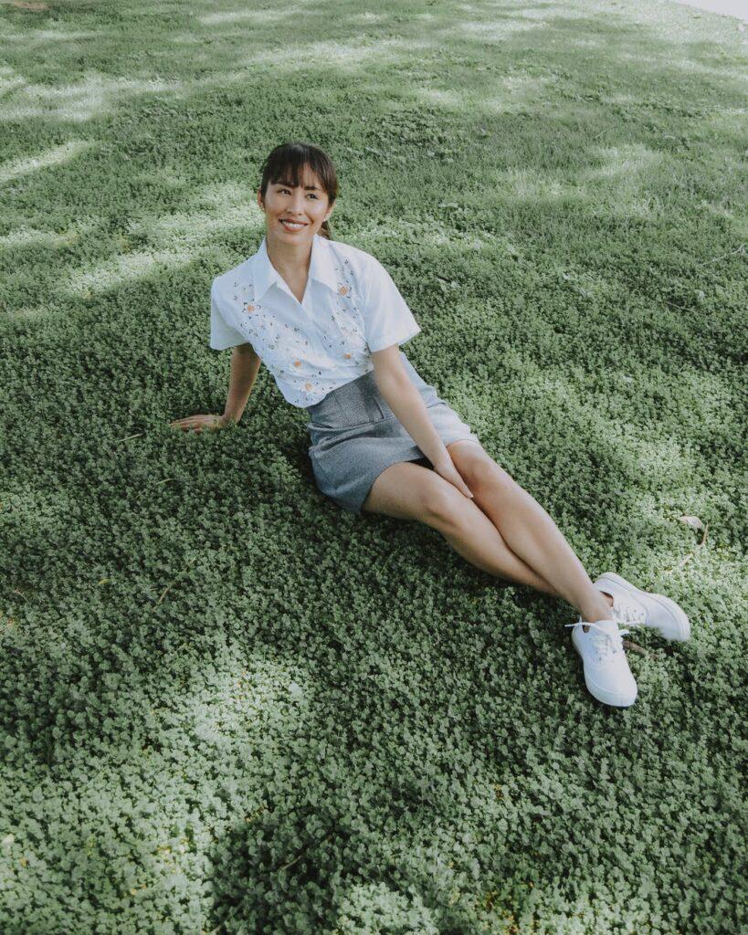high angle photo of woman sitting on grass