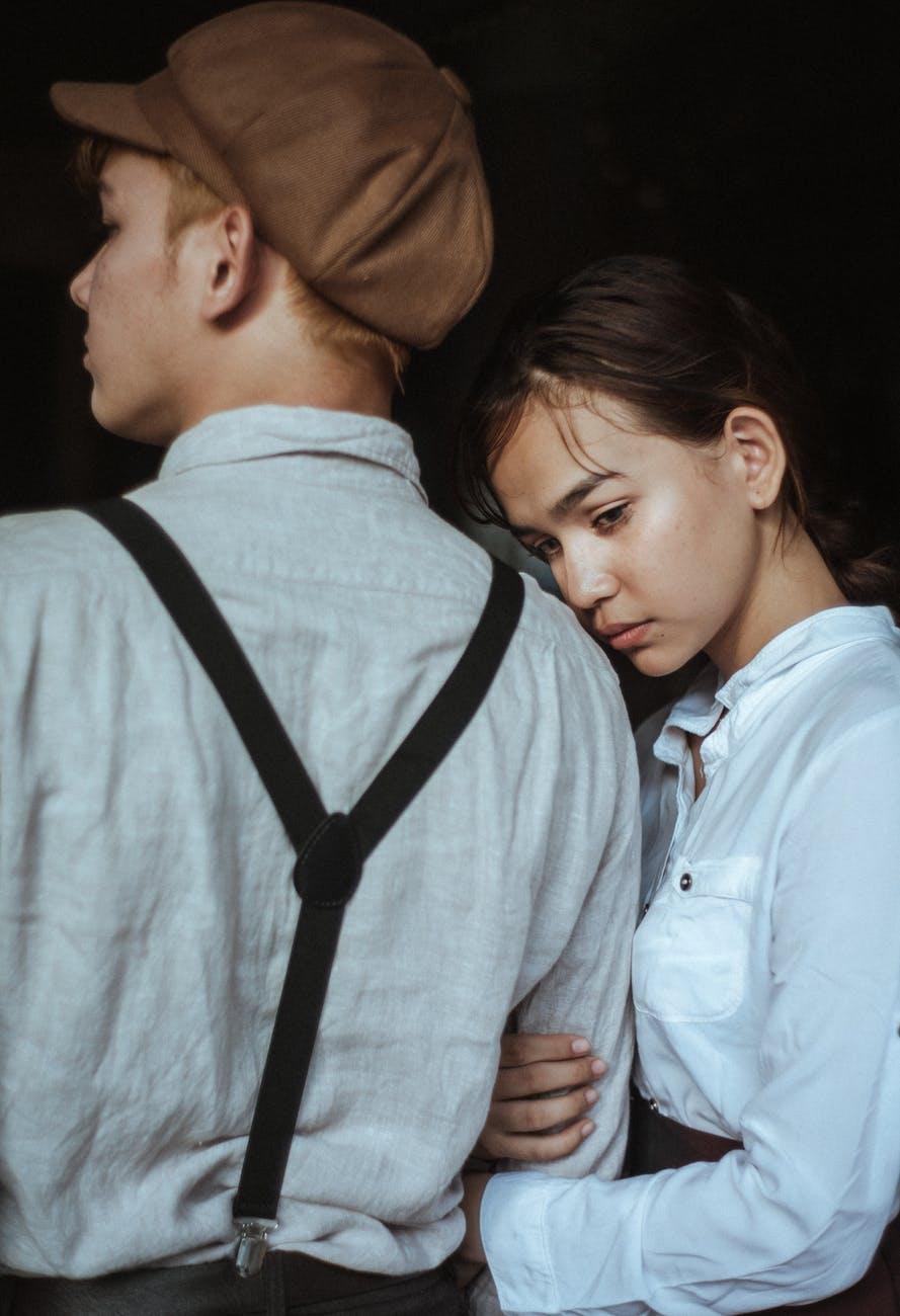 man wearing white shirt beside woman